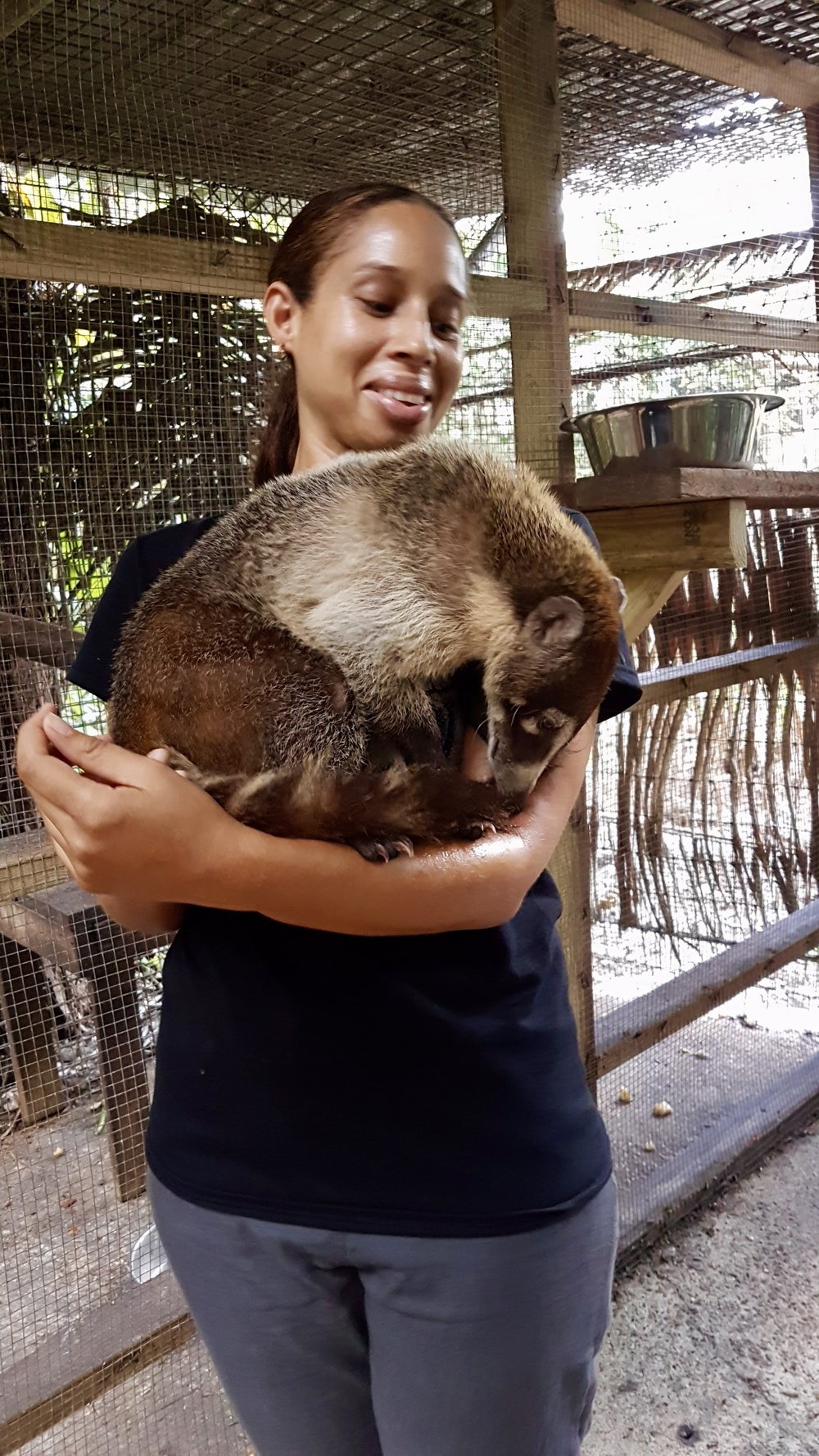 Cristal and her best bud Clarence the coatimundi.