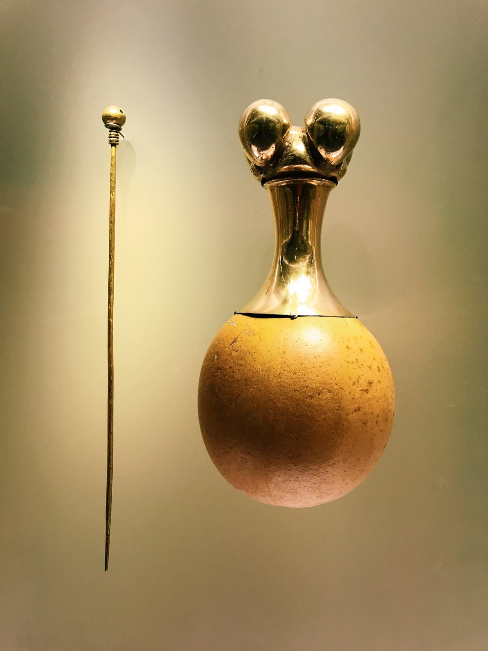 The Spanish stole most of Colombia's gold, but you can still find some in its Museo del Oro. This poporo was used by the indigenous people to carry limes. When they chewed coca leaves, a sacred act, they chewed the lime, as well. That stick was used to bring the lime bits to their mouths.