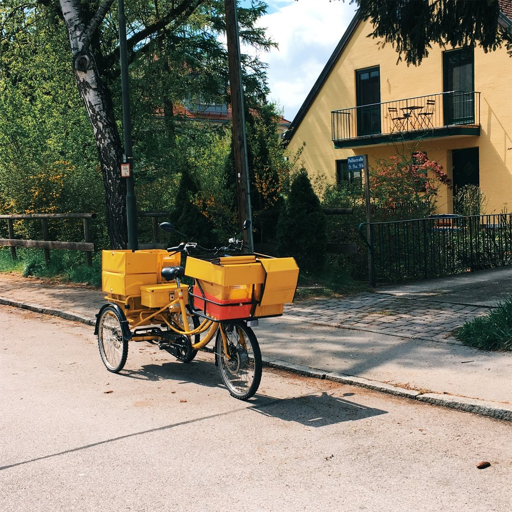 While visiting the Dachau Concentration Camp, we strolled around town and stumbled on this cheerful little bike, which is used to transport mail.