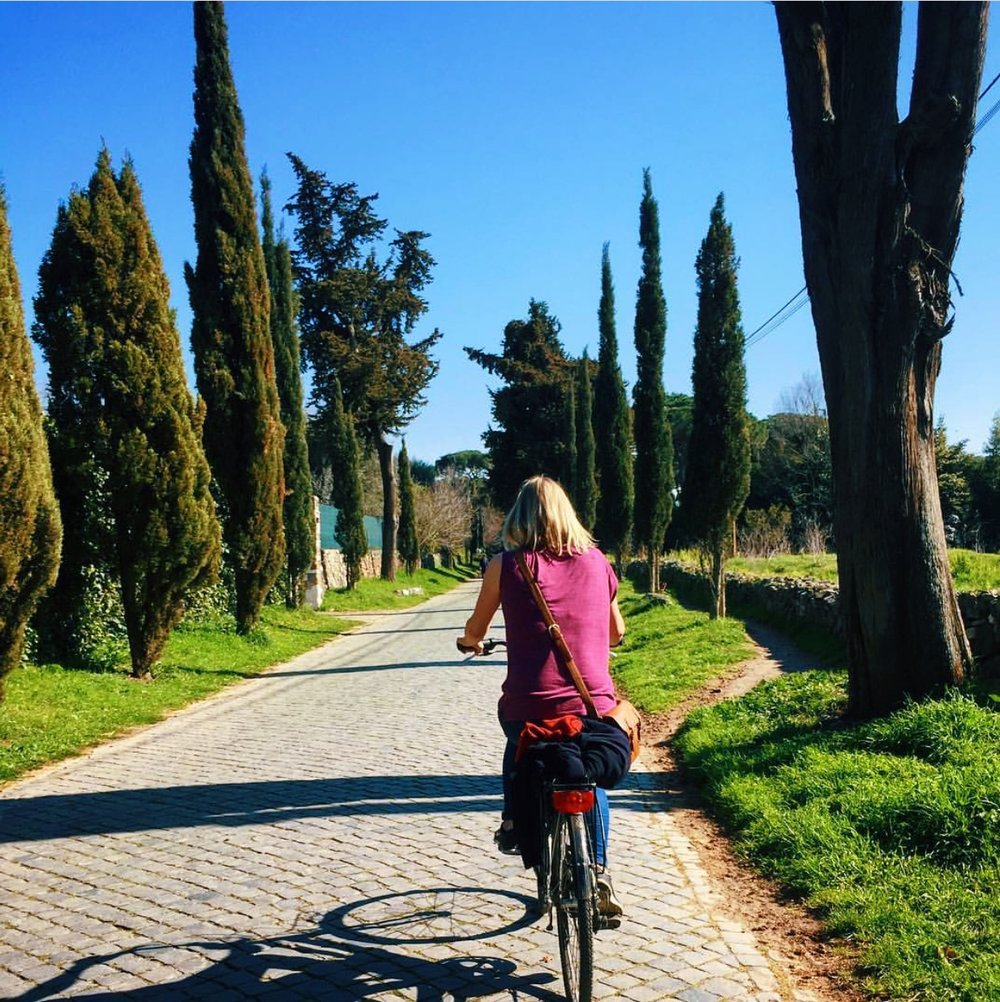 Gemma plans out her travels more rigorously than anyone I know. She even knows where to rent bikes before arriving in a city. Here, she's wheeling through Rome.