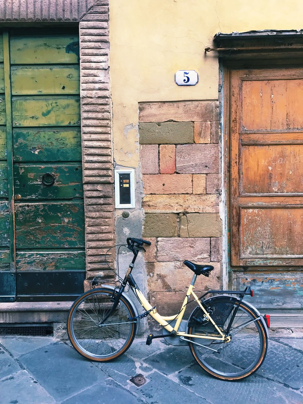 Whether by foot or by bike, weaving your way through Lucca's colorful streets feels absolutely magical.