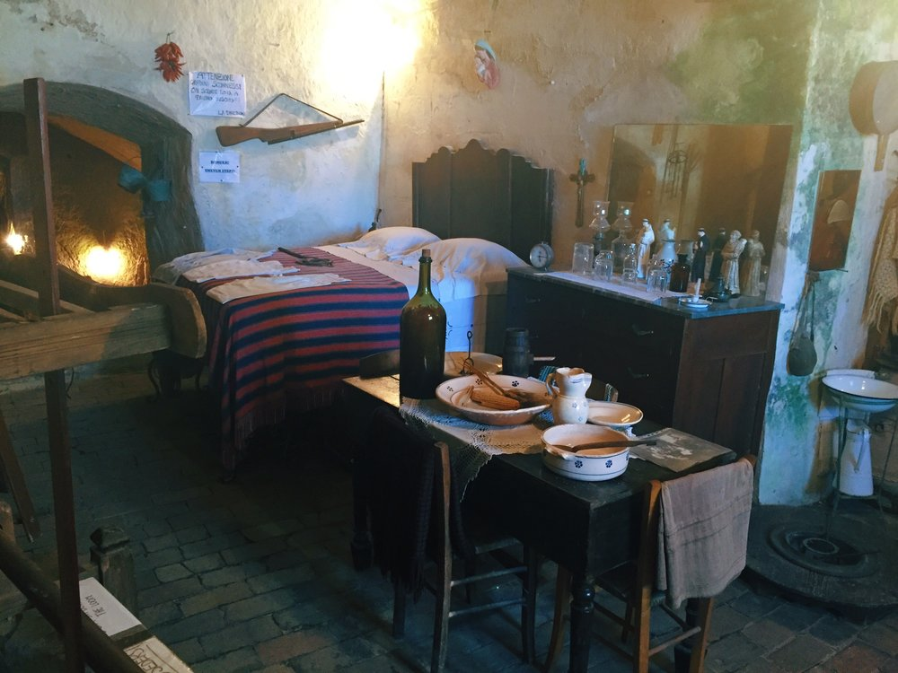 Sassi museum showing how a family lived. Fun fact: The farm animals slept in the caves with them to keep the people warm.