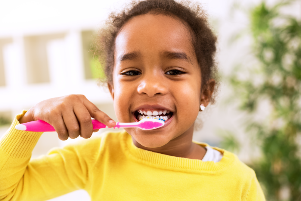 liquid-fillings-girl-brushing-teeth-pediatric-dentistry.png