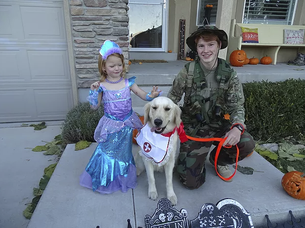 Here is Our Golden Retriever, Pinkerton the nurse, with her Army guy and mermaid!