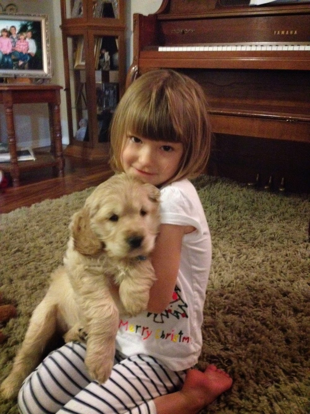 Our sweet daughter Sadie with her puppy Piper Paulette