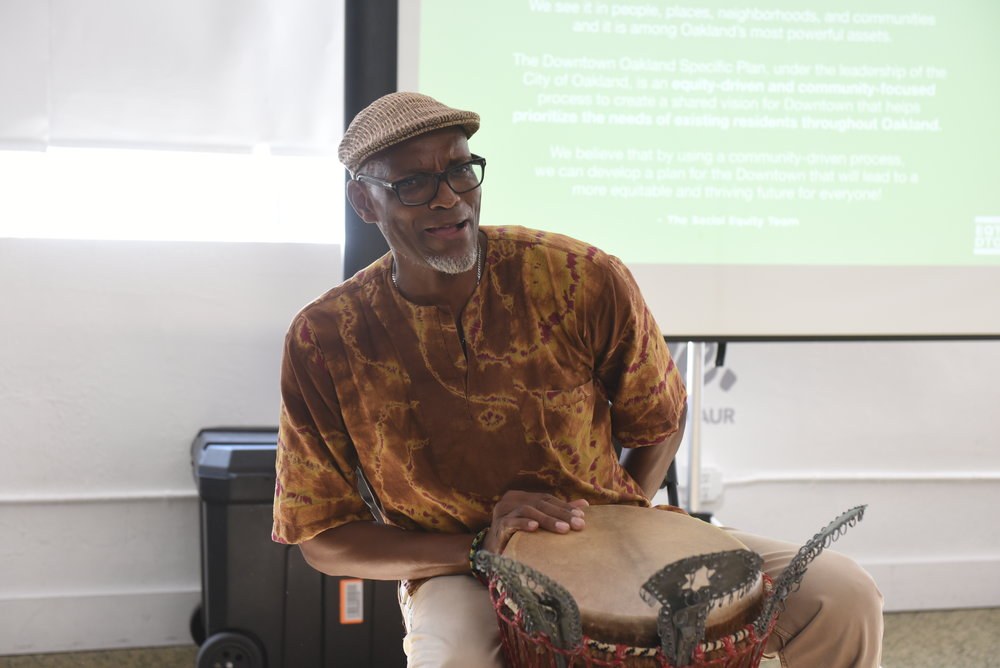 Greg Hodge of the Social Equity Team opening the Social Equity Working Group meeting with African drumming and call-and-response clapping and singing.