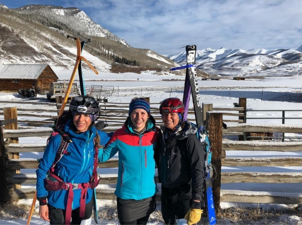 SheJumps' Online Events Coordinator, Sierra Cucinelli (center) flanked by Sarah Pizzo and Julie Nania at the Brush Creek checkpoint/aid station midway through the Grand Traverse ski race in March 2018.