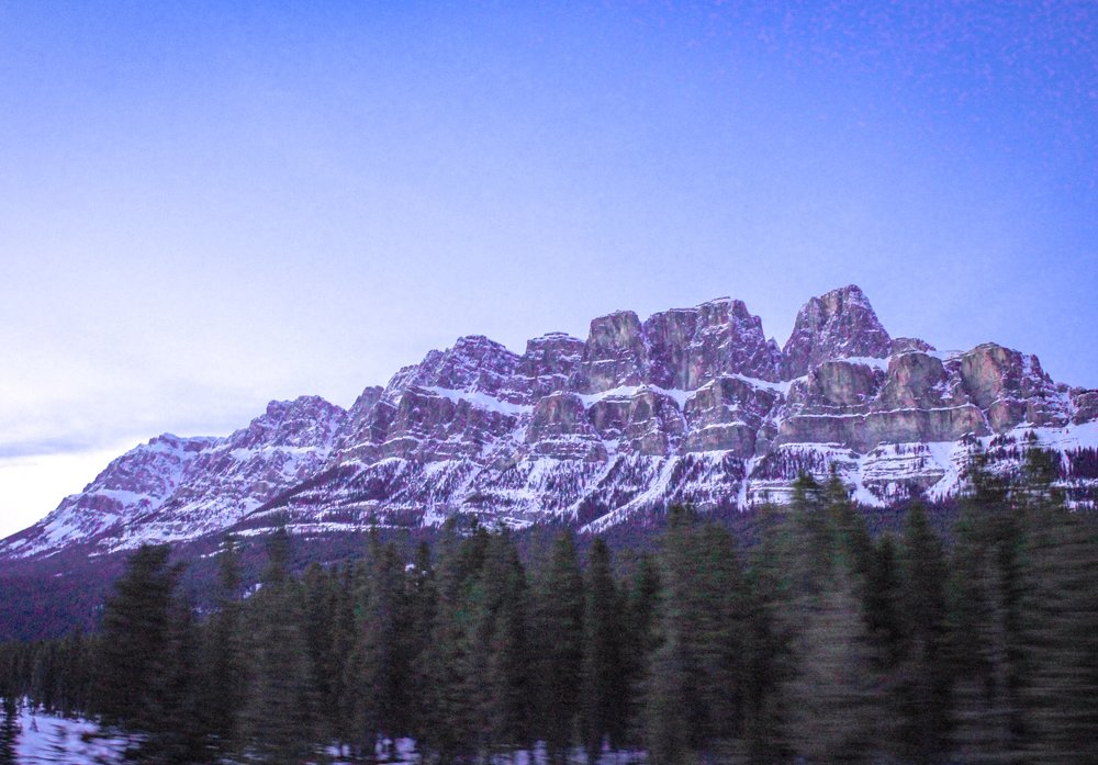 Castle Mountain at sunset, driving westbound on Trans-Canadian Highway 1 towards Lake Louise