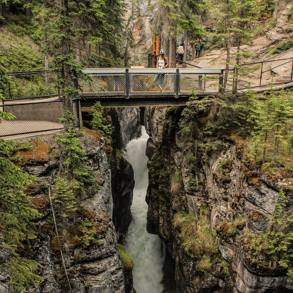 Look down into the thundering rapids of Maligne Canyon