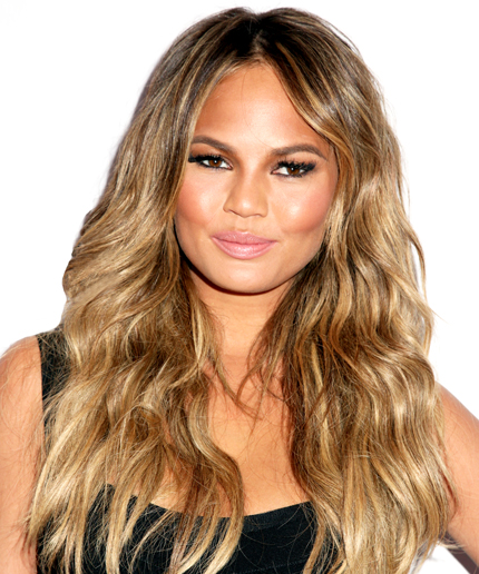 Tape in extensions on my client Chrissy Teigen add length, color, and fullness. Extensions by Priscilla Valles.