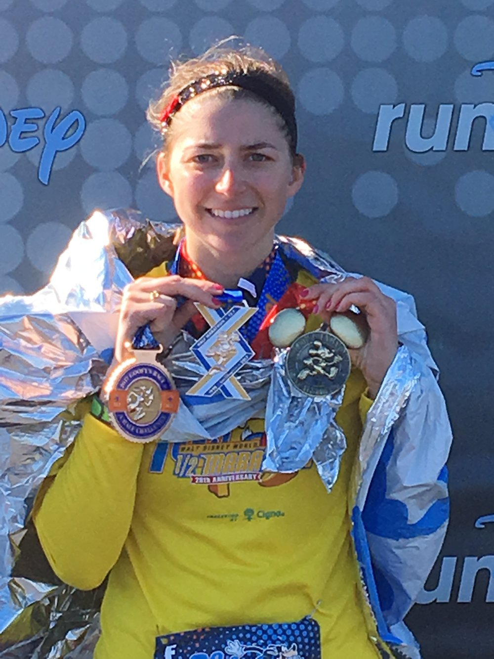 Marathon Recap - This was my second RunDisney race and I had signed-up for the Goofy Challenge thinking that I would be considered a 'real runner' if I could do both a half-marathon AND a full! RunDisney races will always hold a special place in my heart and I am a forever Disney fan- it always makes me feel like a kid whenever I arrive at Magic Kingdom and this race was way more than I could have expected!The race started out SO cold (and of-course I didn't bring any warm-weather gear from Colorado with me), luckily I had a throw-away sweatshirt, mittens, and hat that I purchased from Target. It was also slightly windy, which made me (a person who normally runs cold anyways) even more chilled. It started in Epcot, then we weaved out and made our way to Magic Kingdom, which was way more magical than an expectation I had! Seeing the castle sparkle in the still dark sky was amazing and I began to warm-up, so I dropped off my sweatshirt and hat off to the sidelines.
