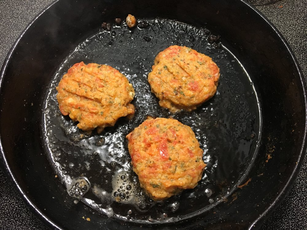 Frying up some sweet potato salmon cakes in coconut oil!