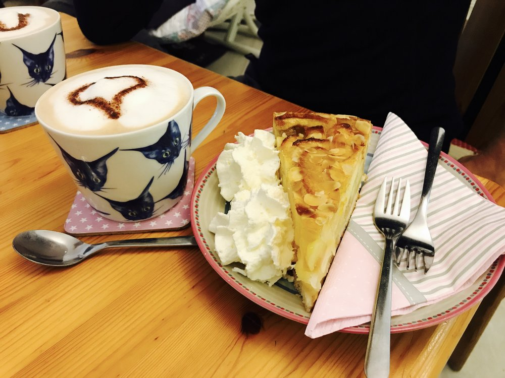 Excellent lattes and apple torte from Pee Pees Katzencafe in Berlin, Germany