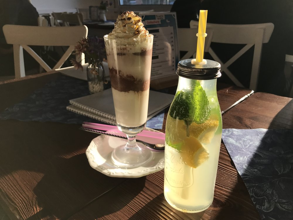 BaristaCats offer a variety of food and beverage, including this housemade lemonade and 'cold cat' ice cream drink