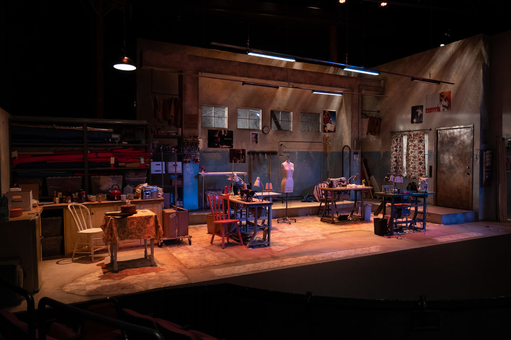 The amazing set from REAL WOMEN HAVE CURVES designed by an all-women creative team:  Scenic designed by TANYA ORELLANA. Light design by KARYN D. LAWRENCE. Props by SYDNEY F. RUSSELL. Sound design by CORINNE CARRILLO. Costume design by JESSICA CHAMPAGNE-HANSEN. Directed by MARY JO DUPREY.