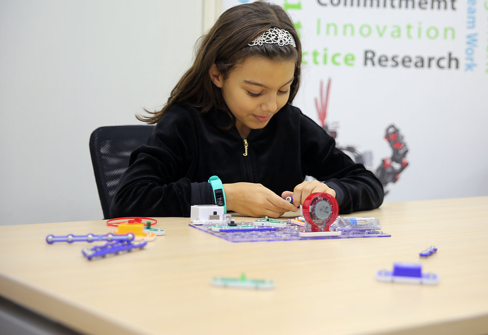 Salma working on her electronics project at IRA.