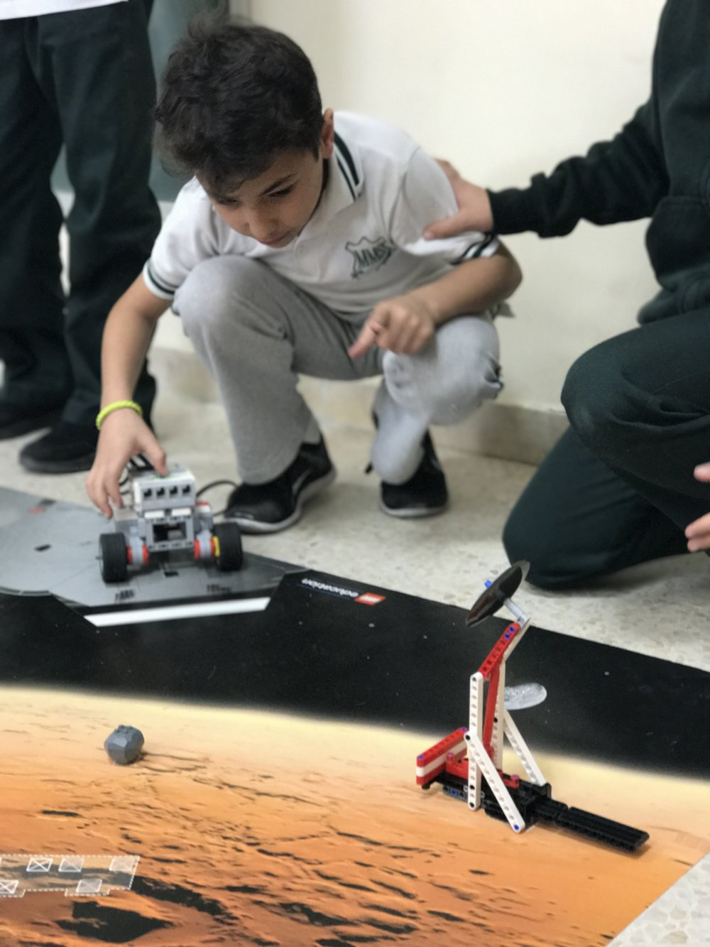 Yousef testing his robot at space mission club
