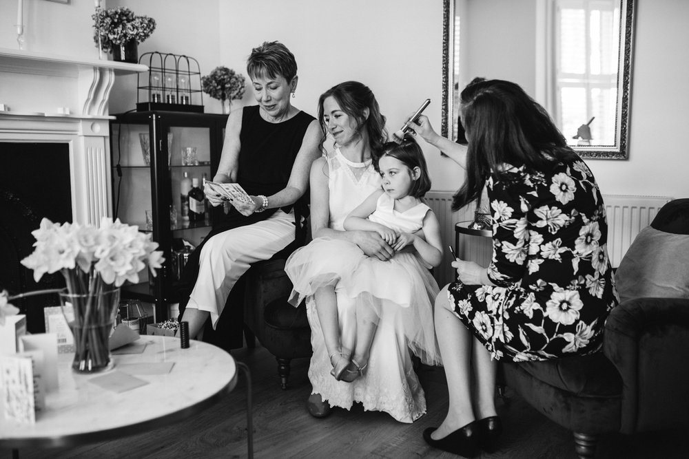 St Albans wedding - bride and mother reading letters