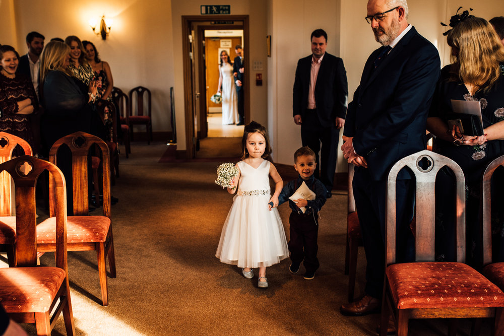 St Albans wedding -flowergirl walking down the aisle at register office