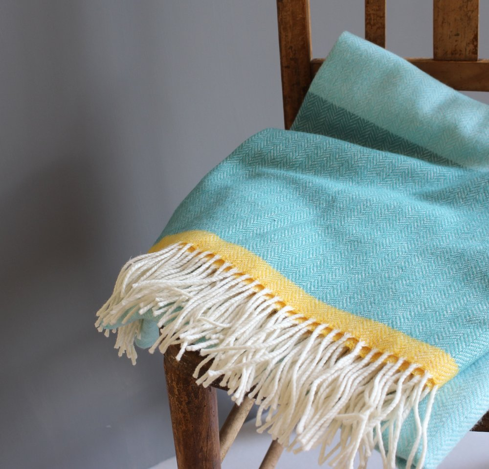 Jessie Teal Throw on chair