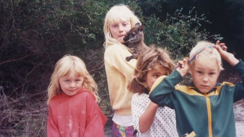 L-R. My sister, me, and two childhood friends with a wallaby we saved from a dog. Flinders Island.