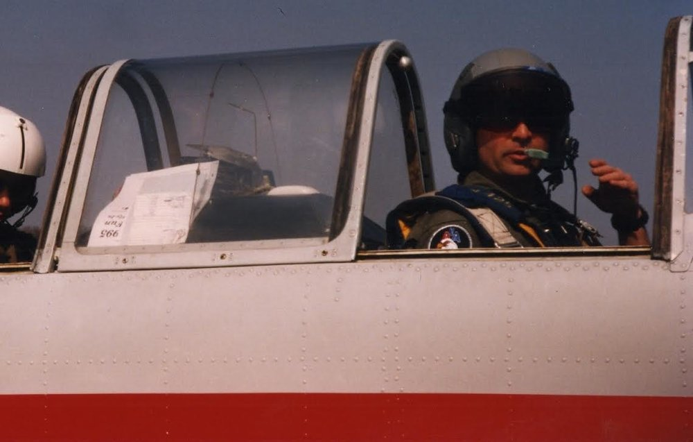 Cole in the cockpit of his aerobatic Yak-52 airplane.