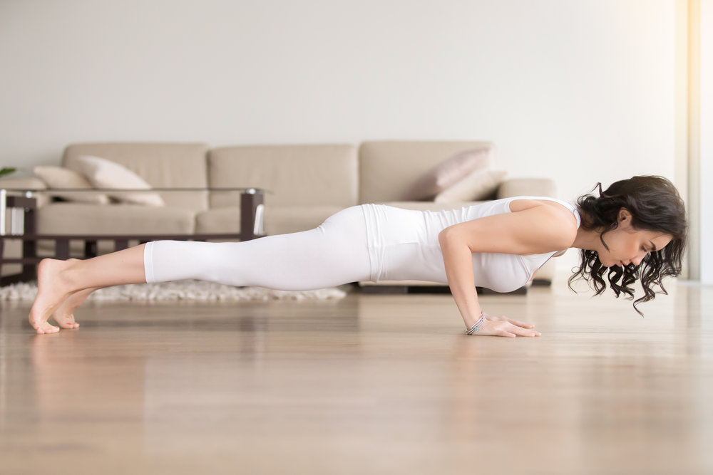 Woman doing pushup hotel room.jpg