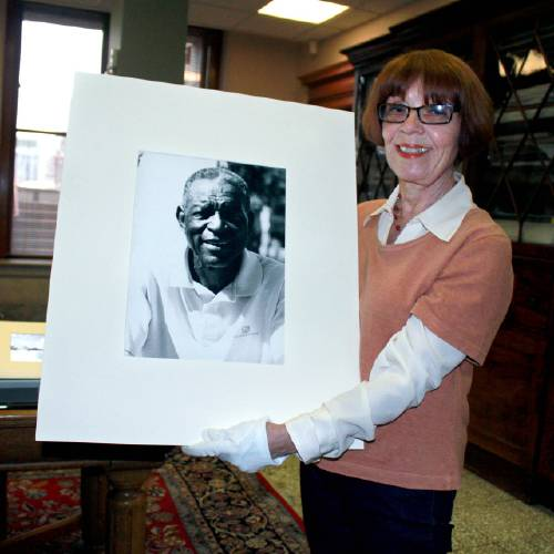 Lucy holding a picture of her late husband Oliver Bell