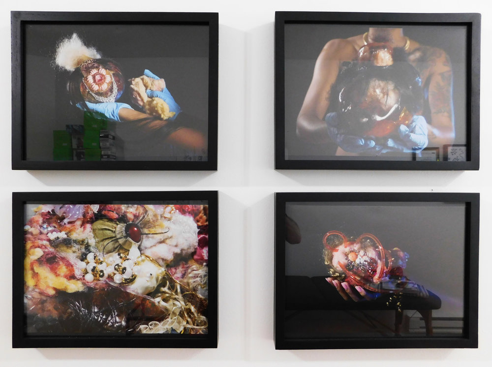 Framed photographs by Doreen Garner (clockwise from top left, all 2014 and 11 x 16 inches):  Diamond ;  Swoop Bang ;  Onika ;  Bisect . Photo by the author.