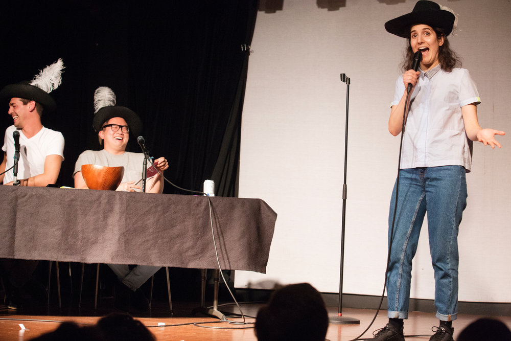 Ana Fabrega  performing at   Las Culturistas   (Podcast hosted by [L-R]  Matt Rogers  and  Bowen Yang  in the background)   LIVE: I Don't Think So, Honey!,   3/21/17, Littlefield, Brooklyn, NY,Photo: Mindy Tucker