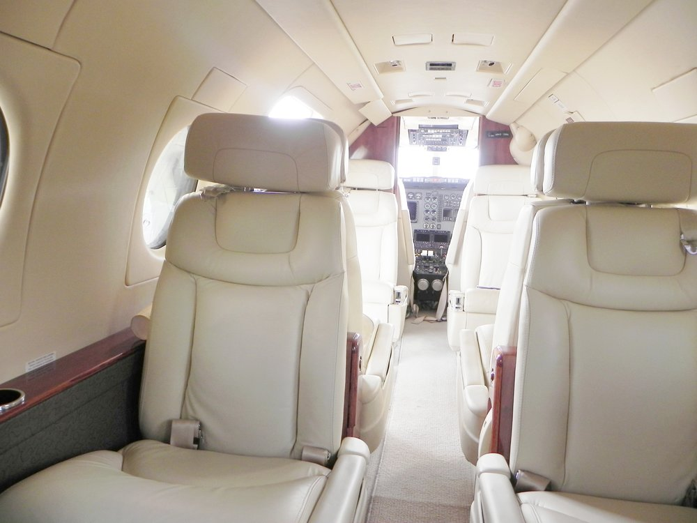 Distinctly admired by owners for its cabin, the Beechjet boasts a vertically square oval design for extra head and shoulder space. This Beechjet 400A maximizes every bit of its cabin with a nine-passenger configuration featuring two sets of newly refurbished, four-place club seats and a belted lavatory seat.