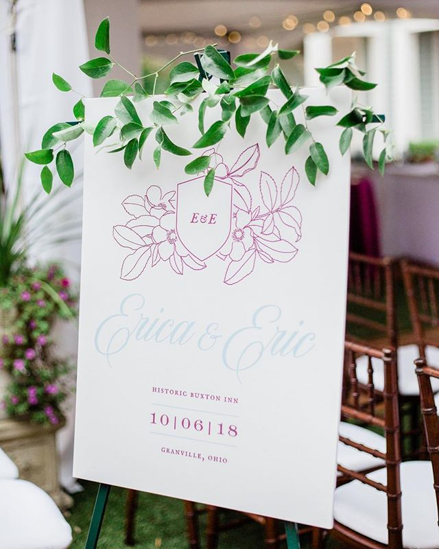 "WEDDING TIP!🥰 When finalizing your stationary items for the day of your wedding (seating chart, welcome sign, etc.) we always urge our clients to go a more classic route for their ""welcome"" sign! We nix the word ""welcome"" which makes it a timeless piece that can be framed + hung in their home to reminisce on their special day! This piece by @cheeruppress had Eric + Erica's signature crest, wedding date, + wedding venue. A cozy reminder of the best day of their lives💕"