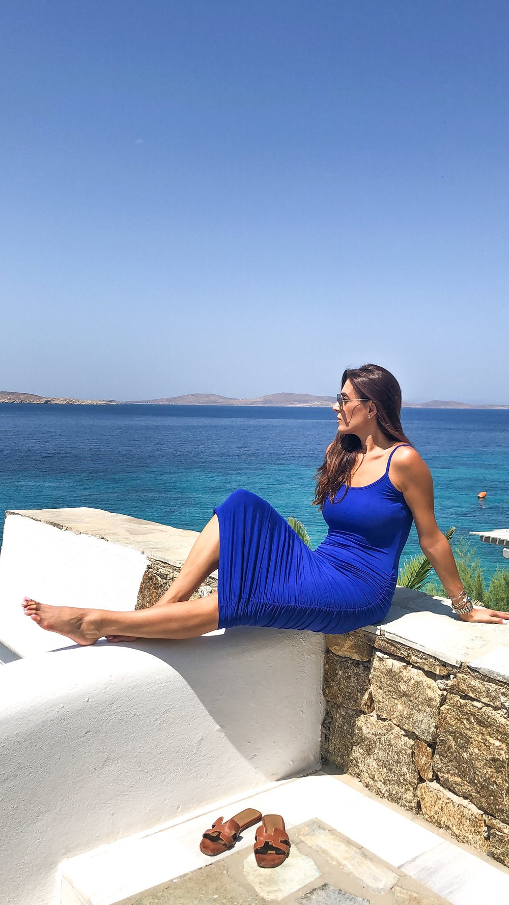 seaside views at  Mykonos Grand Hotel . Dress at  Mystique Boutique  Shoes at  Hermes