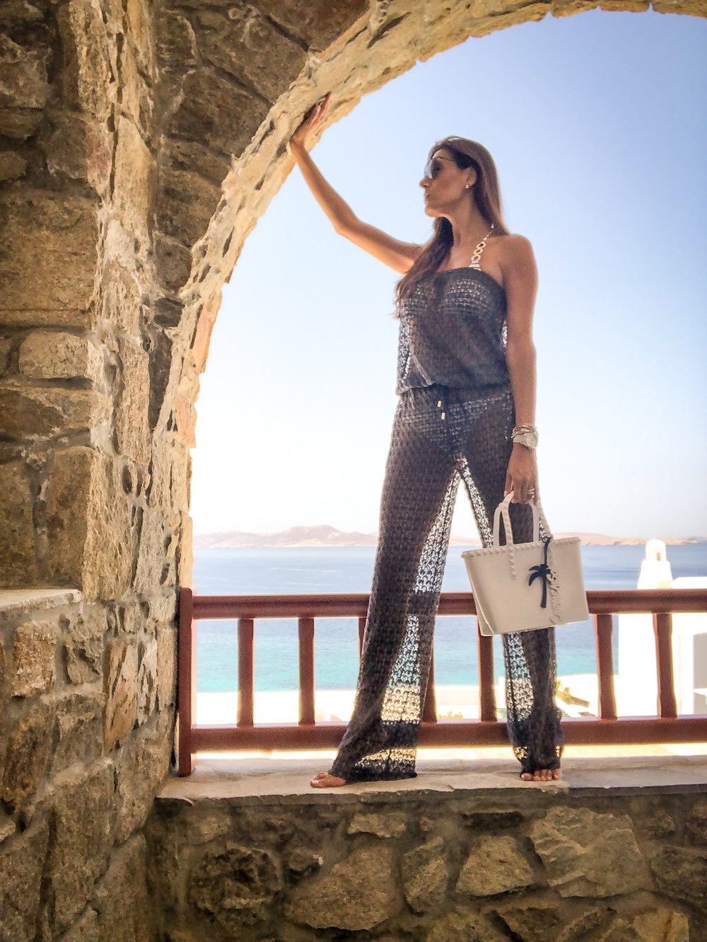 Waking up with the most beautiful sunrise every morning. Full look at  The Shoe Box  Jumpsuit designed by  Melissa Odabash