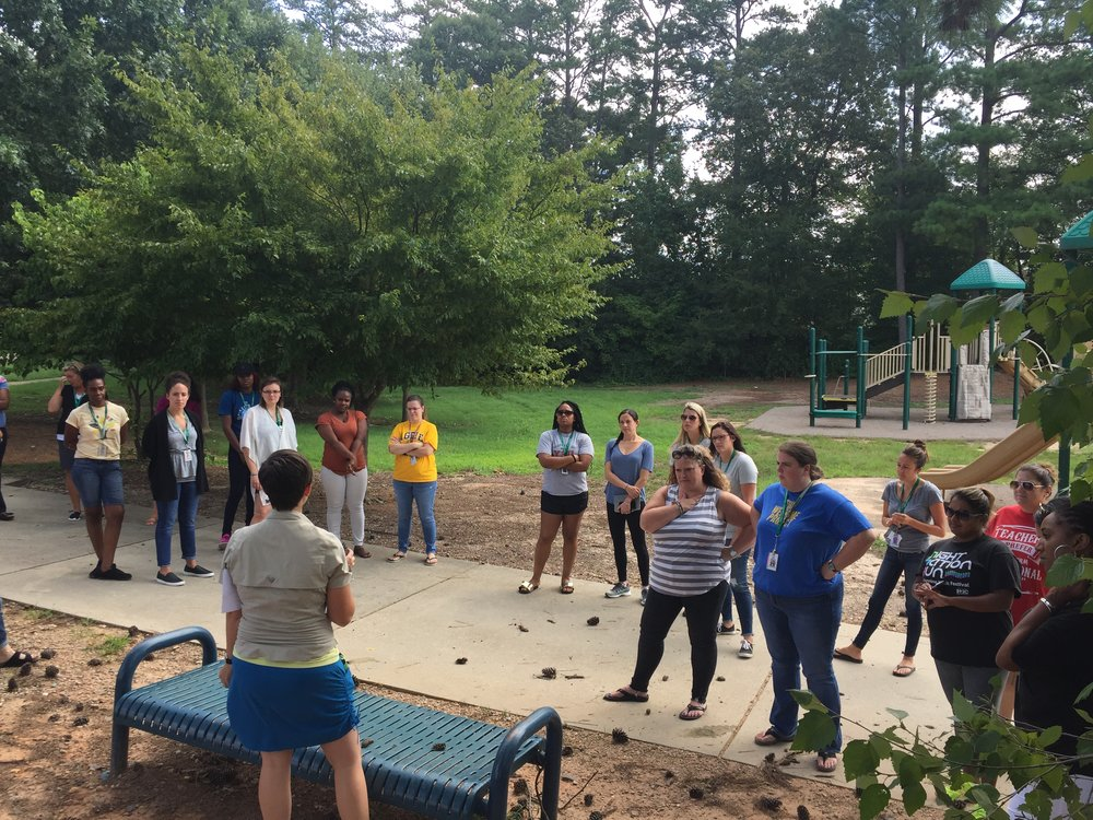 Teachers learning about the impact of squirrels in their schoolyard.  Photo courtesy of Sean Russell, MECME