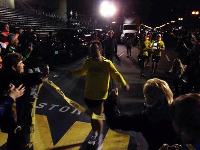 Dave McGillivray crossing the finish line of the Boston Marathon shortly after 11 p.m. on Marathon Monday.