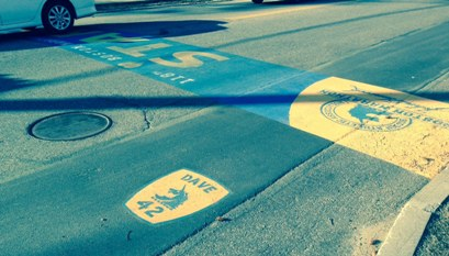 Insignia in road marking Dave McGillivray's 42nd Boston Marathon.