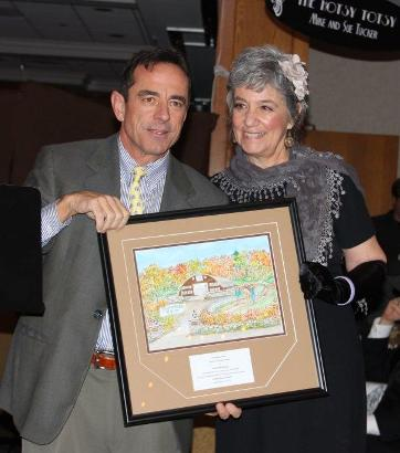Dave McGillivray (left) accepts award from Deedee O'Brien, Executive Director of Ironstone Farm.