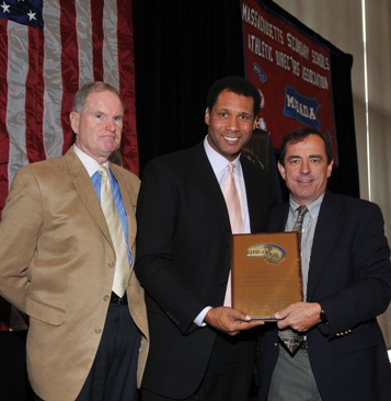 William Gaine, the MIAA Deputy Director, (left) and Steve Burton of WBZ-TV (center) present the 2010 Ron Burton Community Service Award to Dave McGillivray, president of DMSE Sports, Inc.  GrynnAndBarrett