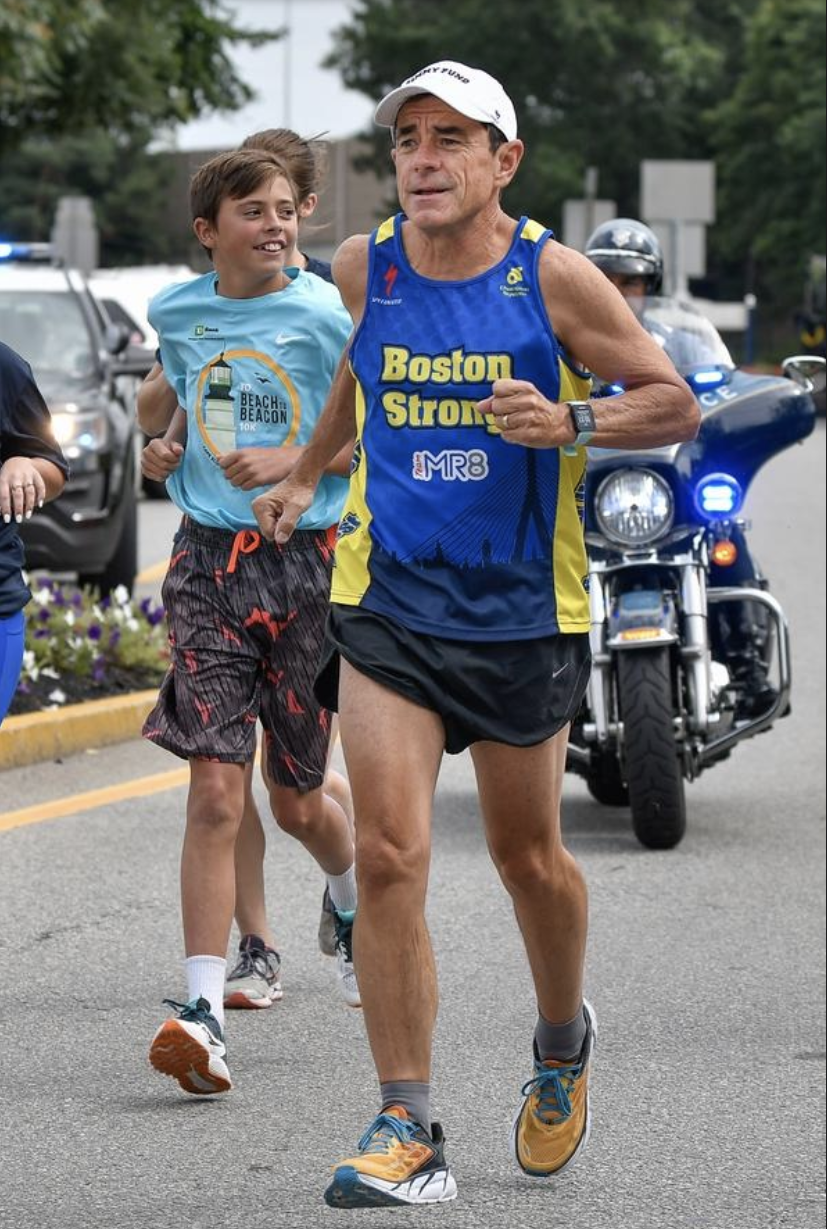 Luke McGillivray, left, runs along with his father Dave McGillivray, right, as they start their run from Medford City Hall to Fenway Park to commemorate Dave's 40th Anniversary of running from Medford, Oregon to Medford, MA to raise money for the Jimmy Fund, on Thursday, Aug. 23, 2018. [Wicked Local Staff Photo / David Sokol]