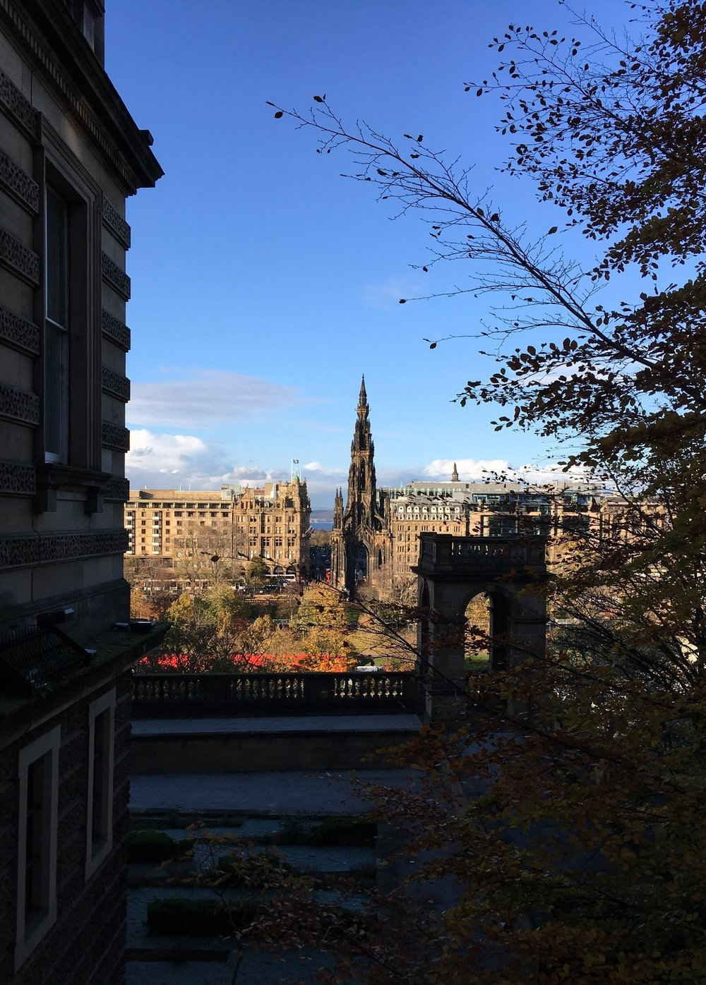 Looking down at the Scott Monument from some hilly terrain