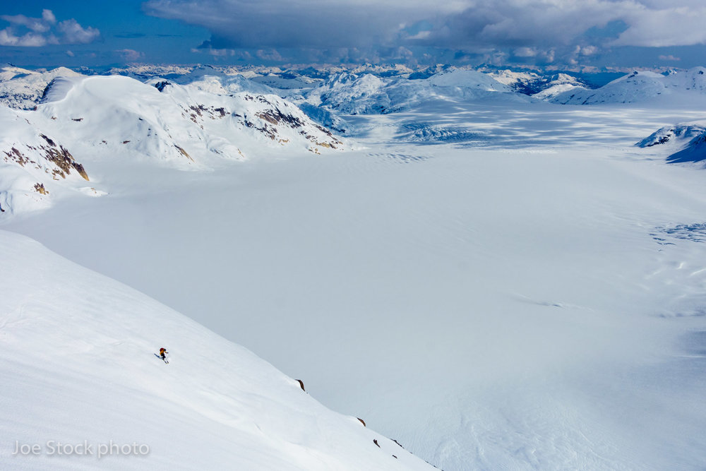 Tobey Carman skis 2,500-feet of corn in Prince William Sound in mid-April. Cathy, Tobey, Cortney, Eric Larson and I spent an epic week out here, skiing chutes and faces off nunataks above the ocean and icefields.