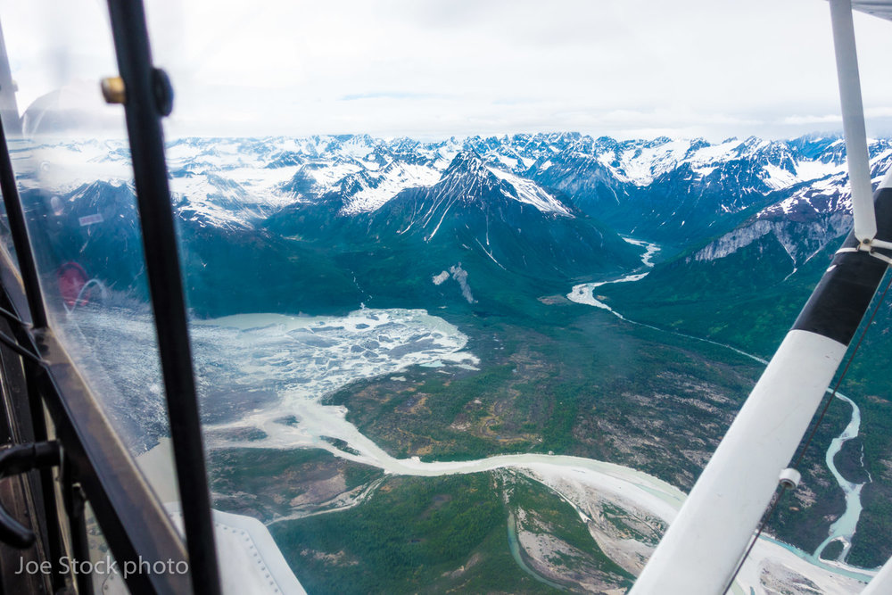 "Entering the Neacolas, above the Blockade Glacier and the McArthur River, riding the Super Cub like a bucking bronc in pounding wind. Our first choice landing zone wasn't happening. Pilot Ben Knapp and I turned east toward Cook Inlet. Looking for another zone. Recently, I've grown to enjoy picking base camp locations on the fly. Just looking out the window, then pointing over the pilot's shoulder and saying into the headset, ""Right there!"" And anyway, trips are not supposed to go as planned in Alaska. If they went as planned, it wouldn't be an adventure."
