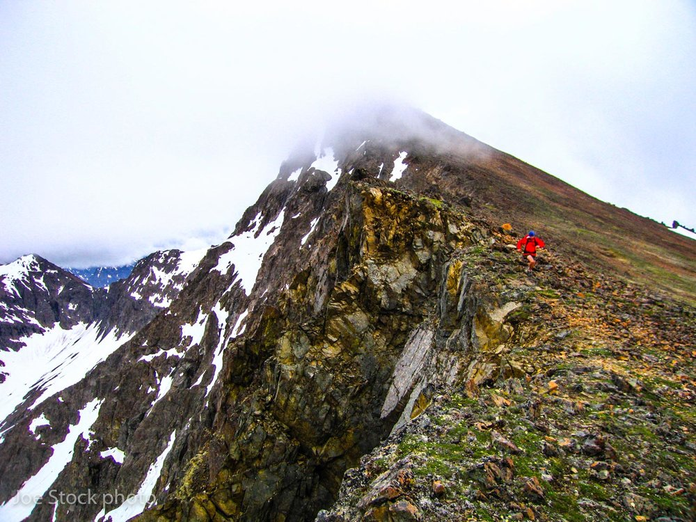 To learn the route, I spent a few years of summer evenings and weekends peak bagging and running in the Chugach Front. Almost always alone, pushing the limit of my body. This photo is from a day with Andrew McCarthy when we linked up six of the high peaks.