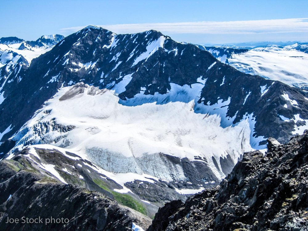 A small, unnamed glacier in the Chugach Mountains. This glacier's equilibrium line altitude is at a good position for a healthy glacier. The problem is, this photo was taken in early July. Two months of summer melt season remain. Many small glaciers in Alaska will soon be gone.