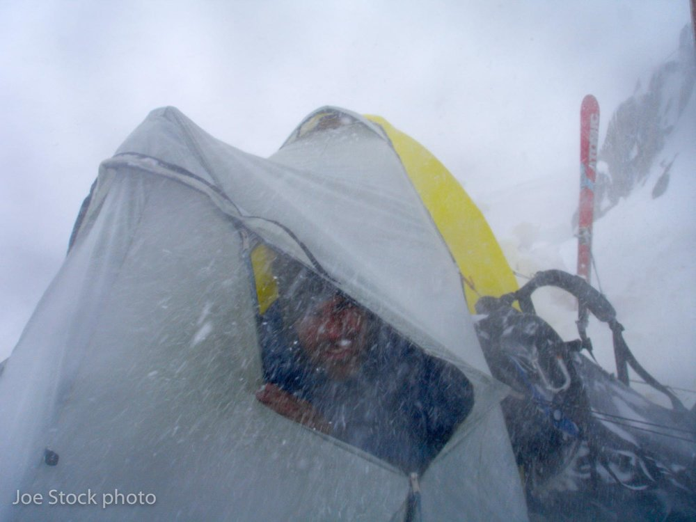 Wex waiting out day three of a mega storm that pounded our Bibler tent with 100 mph winds.