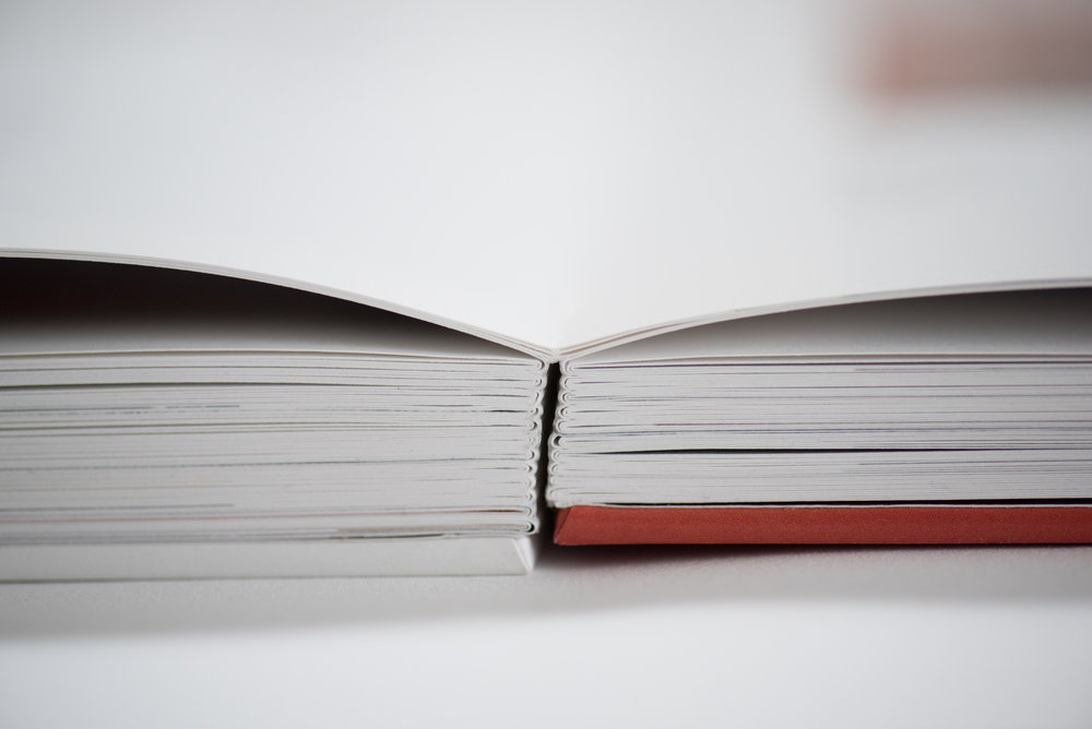Soft fabric spine that allows the book to lay virtually flat