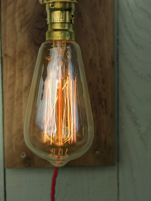 Copper wall light with wooden backboard squirrel cage filament bulb copper wall light with wooden backboard squirrel cage filament bulb and fabric covered flex aloadofball Images