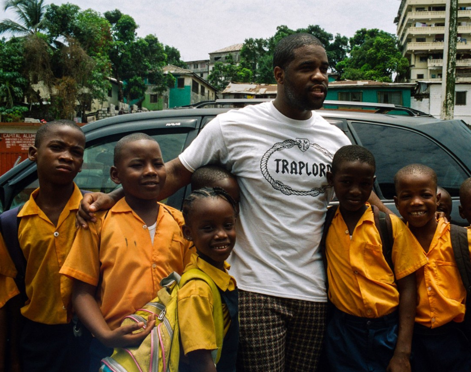Ferg had the opportunity to travel to Liberia with Liberty and meet the women who work in Uniform's factories. He also spent time with the kids who would receive the new uniforms, as captured by photographer Daniel Arnold in the images below.