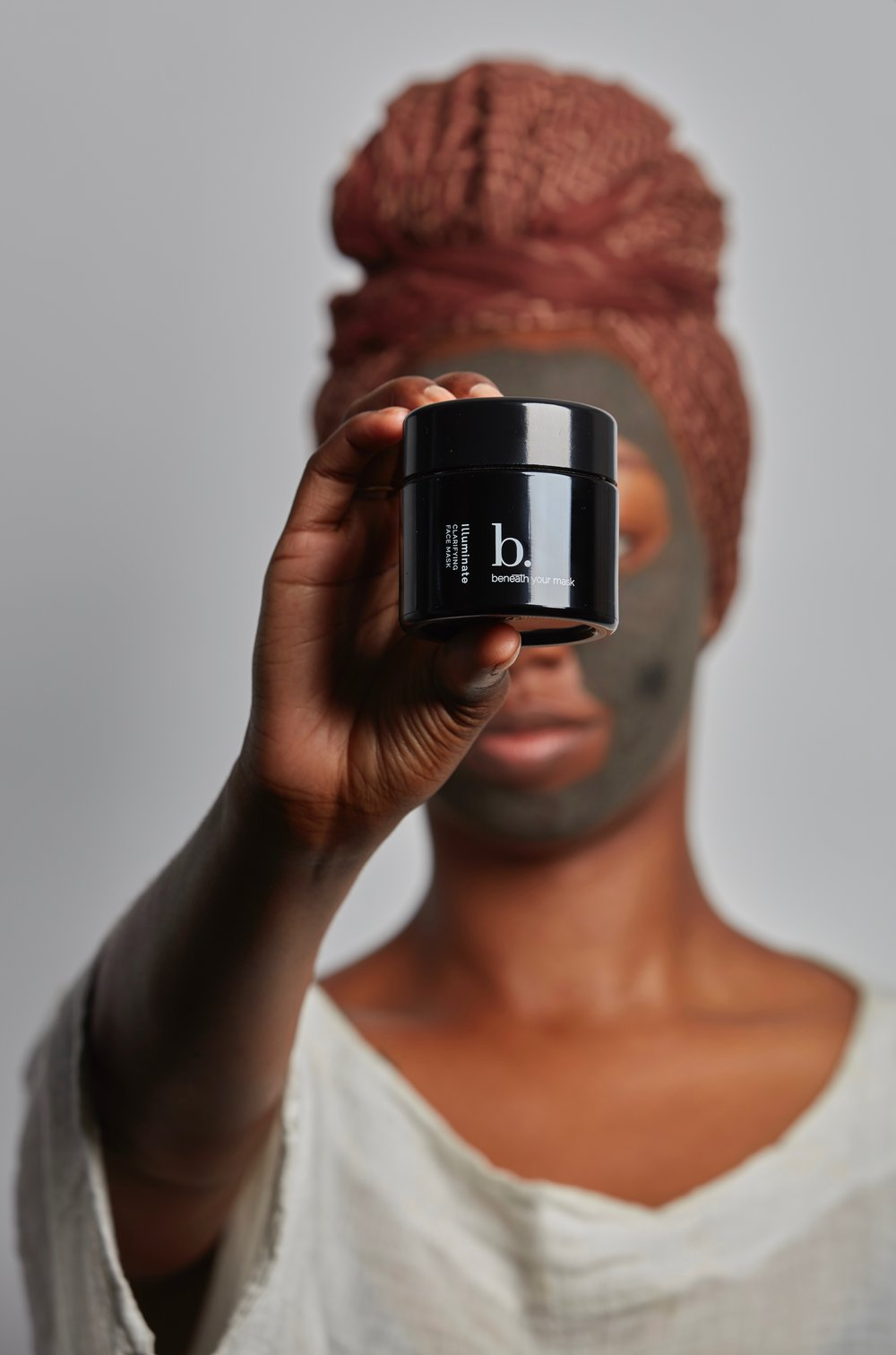 MelninASS Founder Dominique Drakeford trying the Clarifying Face Mask